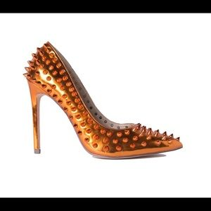 Akira Metallic Orange Spike Heels